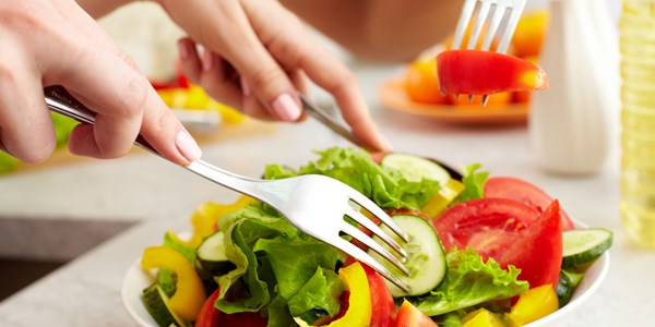Close-up of human hands with forks tasting salad; Shutterstock ID 82023532; PO: aol; Job: production; Client: drone